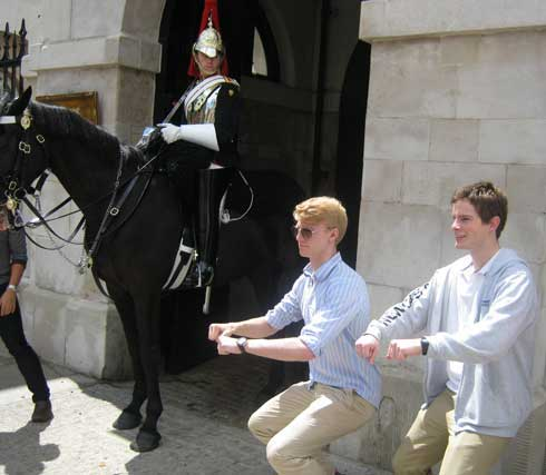 Two men imitating a palace guard in London.