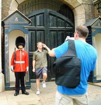 A man on one of Richard's tours marching alongside a guard at St James's Palace.